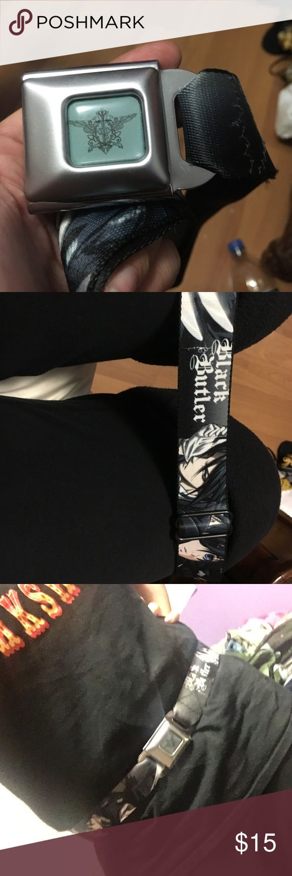 Black Butler belt Has Ceil and Sebastian on it. Seat belt buckle. Has Black Butler across it. Adjustable. Hot Topic Accessories Belts