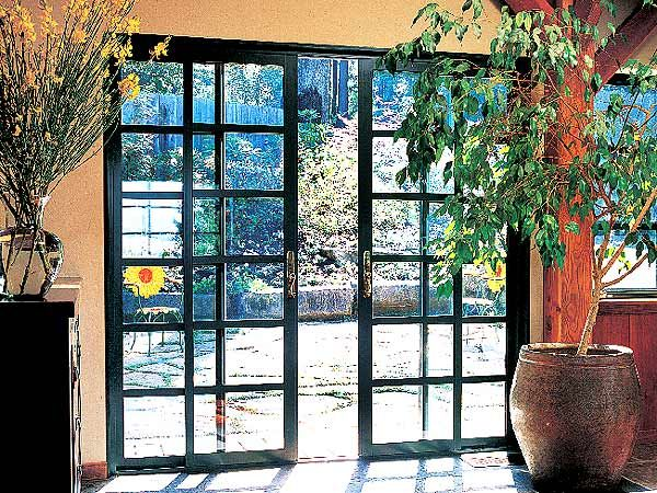 These green sliding french doors make a fitting transition for Green french doors