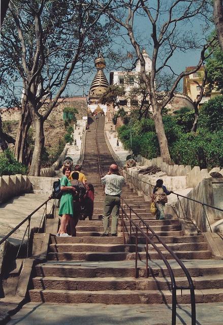 Climbing the steps up to Swayambhunath  (Monkey Temple) Kathmandu, Nepal