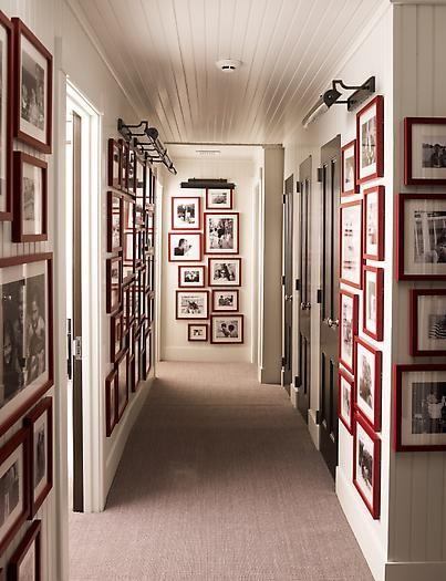 An amazing gallery hall using all red frames this really brings attention to the black