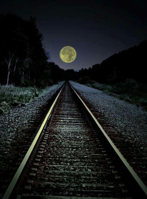 Moon over train tracks