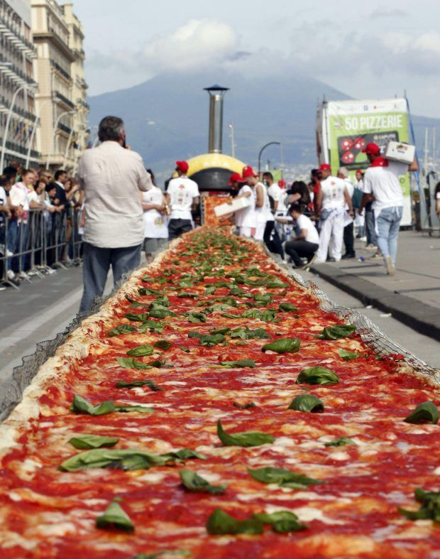 Heaven is Naples, Italy, where the gelato is flowing and there's a pizza that's over a mile long. Glorious.  More than 400 chefs from around Italy met by the water in Naples to create a 1,853 metre long pizza, breaking the record for the world's longest pizza.
