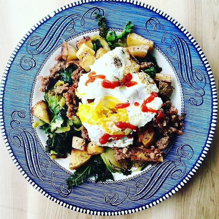 I could eat this every single day on my favorite chippy blue plate.  Kale and brussel sprouts cooked in a little EVOO and chicken broth with American fries and Italian sausage and topped with an over easy egg and siracha. This took me about 10 minutes to make and about 2 seconds to devour. by chelsie.does.glutenfree