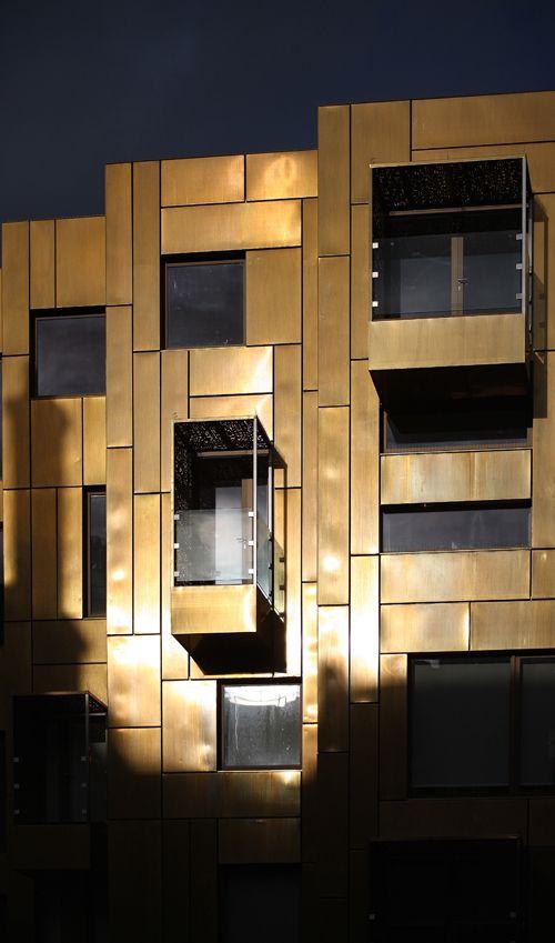 10 Weymouth Street's brass cladding exterior shining in the evening sun