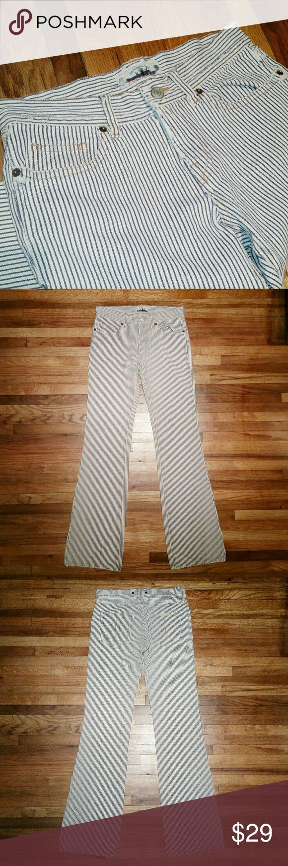 FORNARINA railroad stripe jean sz 27 Flare jean with ticking stripe.   Approx measurements taken flat: Waist 13.5 Hip 17.25 Inseam 33 Hem opening 9.0 Rise 9.0 front 11.0 back Fornarina Jeans Flare & Wide Leg