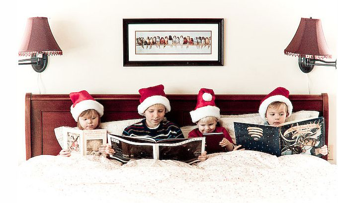 a Fun idea for shooting kids for a Christmas photo shoot, reading holiday books in bed