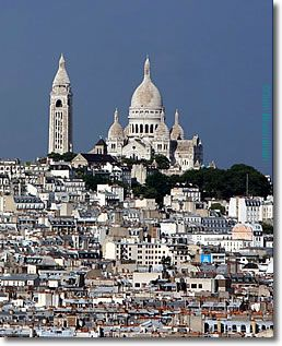 Montmartre, Paris. It's nice to sit on the steps of Sacre de Coeur and see the entire beautiful city at your feet.  Especially the revolving light at the Tour de Eiffel