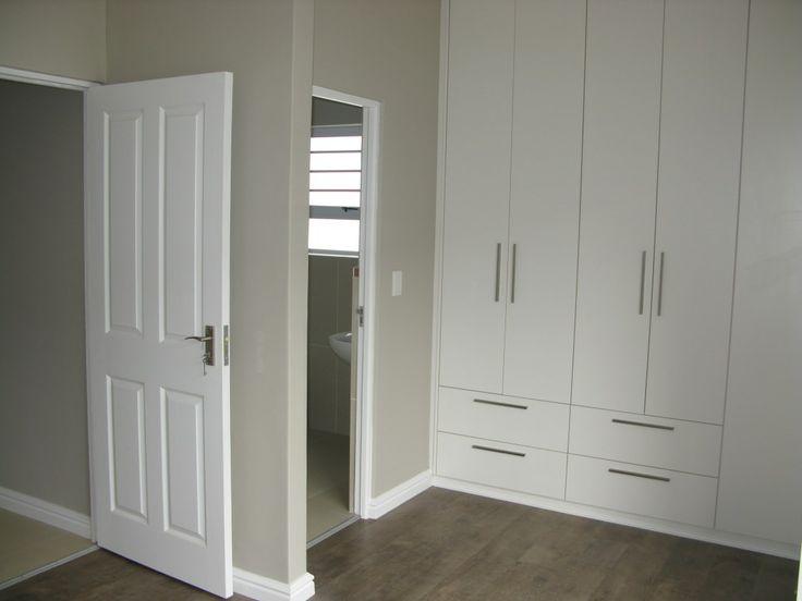 Main bedroom with built-in-cupboards and en-suite