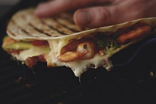 Shrimp & Jack Quesadilla. Plump shrimp, pepper Jack cheese and fresh avocado grilled up toasty and warm. A touch of cayenne brings a little heat.