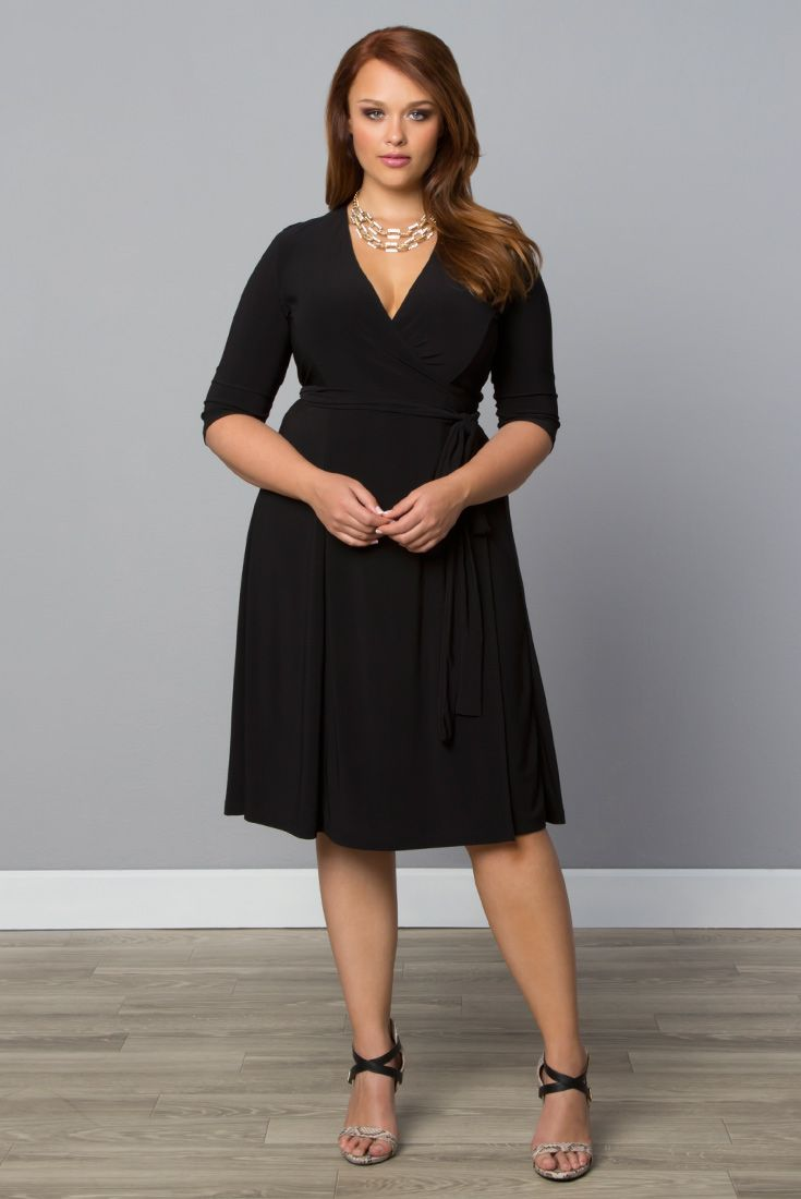 Every woman should own a classic wrap dress and the perfect little black dress and our plus size Essential Wrap Dress is both. Browse our entire made in the USA collection online at www.kiyonna.com. #KiyonnaPlusYou