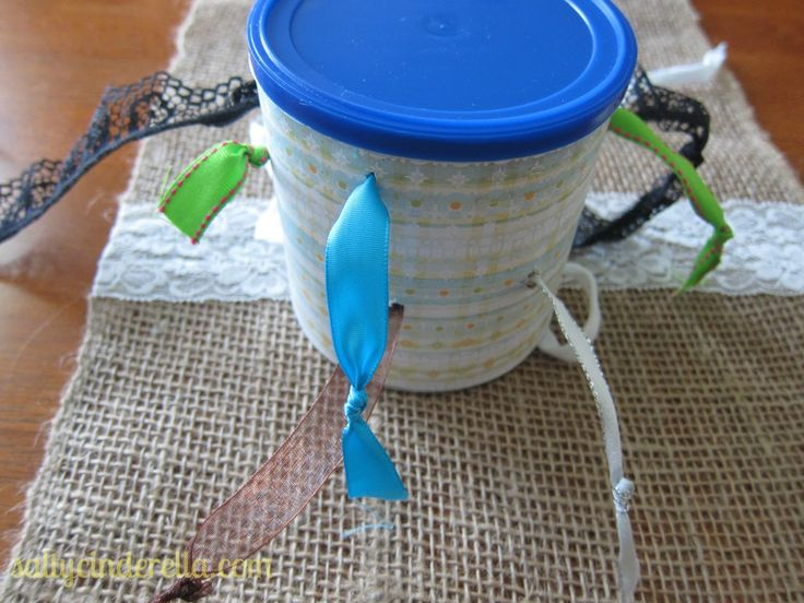 toddler activity ribbon  pull can – use saved up cans and make for play group friends