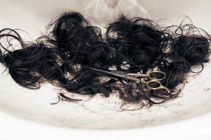 I stared at the ragged locks of hair that now lay in the sink, in a hazy sort of shock. Impulsive. Stupid...brilliant. In stared hard at the mirror, in the dark of the bathroom, with a giddy sort of feeling in my chest.