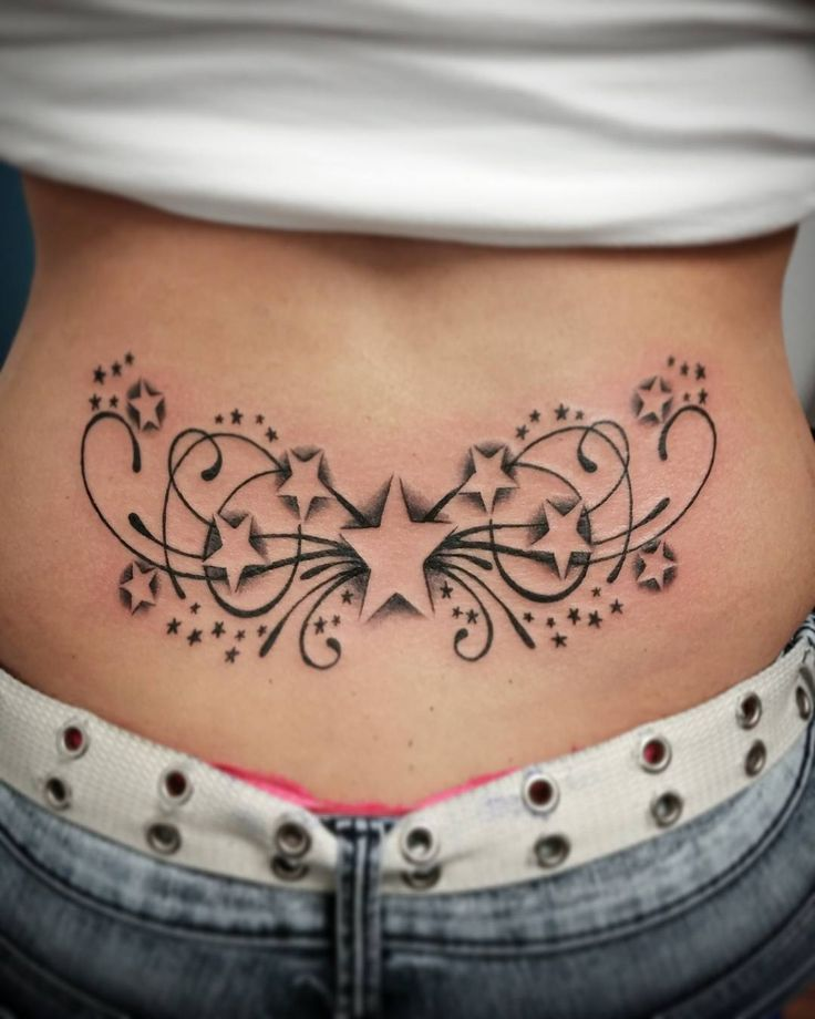 Stars & Swirl Lower Back Tattoo