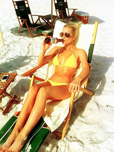 Wow - Kellie Pickler rockin' a little yellow bikini drinking a cold beer on the beach.