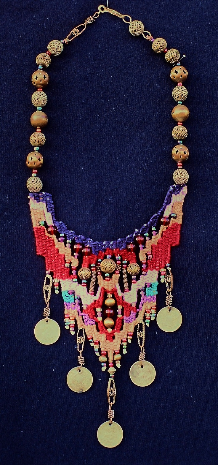 Necklace I designed in the style of Helen Banes. These are pearl cotton threads and found beads and coins. 1996. Polly McCann