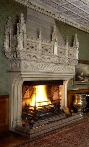 View of the Main Hall at Tyntesfield, North Somerset with huge stone carved fireplace