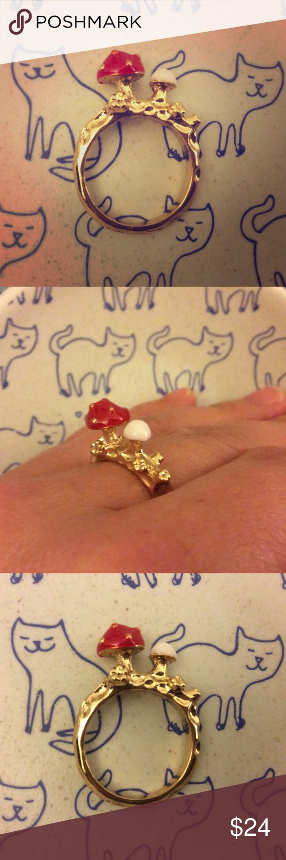 Tiny mushroom ring cute kawaii Japanese jewelry This adorable ring features a red cap mushroom and a tiny white shroom next to it. Gold colored hardware. Approximate size 7. Purchased from our last trip to Tokyo Japan. Check out our other listings to bundle! Not urban outfitters. Super cute  kawaii  kitsch  indie  adorable  Japanese  Japan Urban Outfitters Jewelry Rings