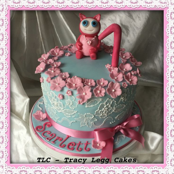 This was a double tier vanilla cake finished with hand piped brush embroidery and fondant character