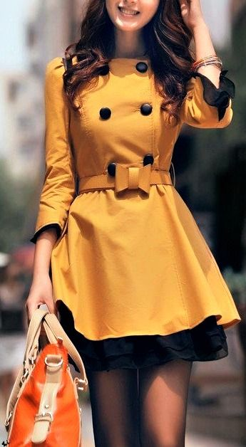 The yellow/black combination is beautiful. The buttons add a vintage touch to the coat. The bow makes it feminine. I love how the coat flares into a skirt :)