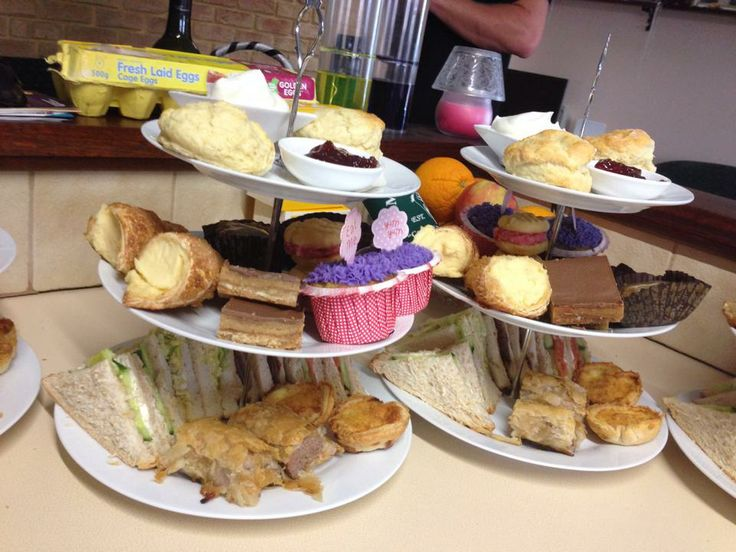 High Tea: Assorted Sandwiches, Sausage Rolls, Quiches Vanilla Cupcakes, Caramel Slice, Custard Horns, Sticky Date Slice, Raspberry Melting Moments Scones with Jam and Cream