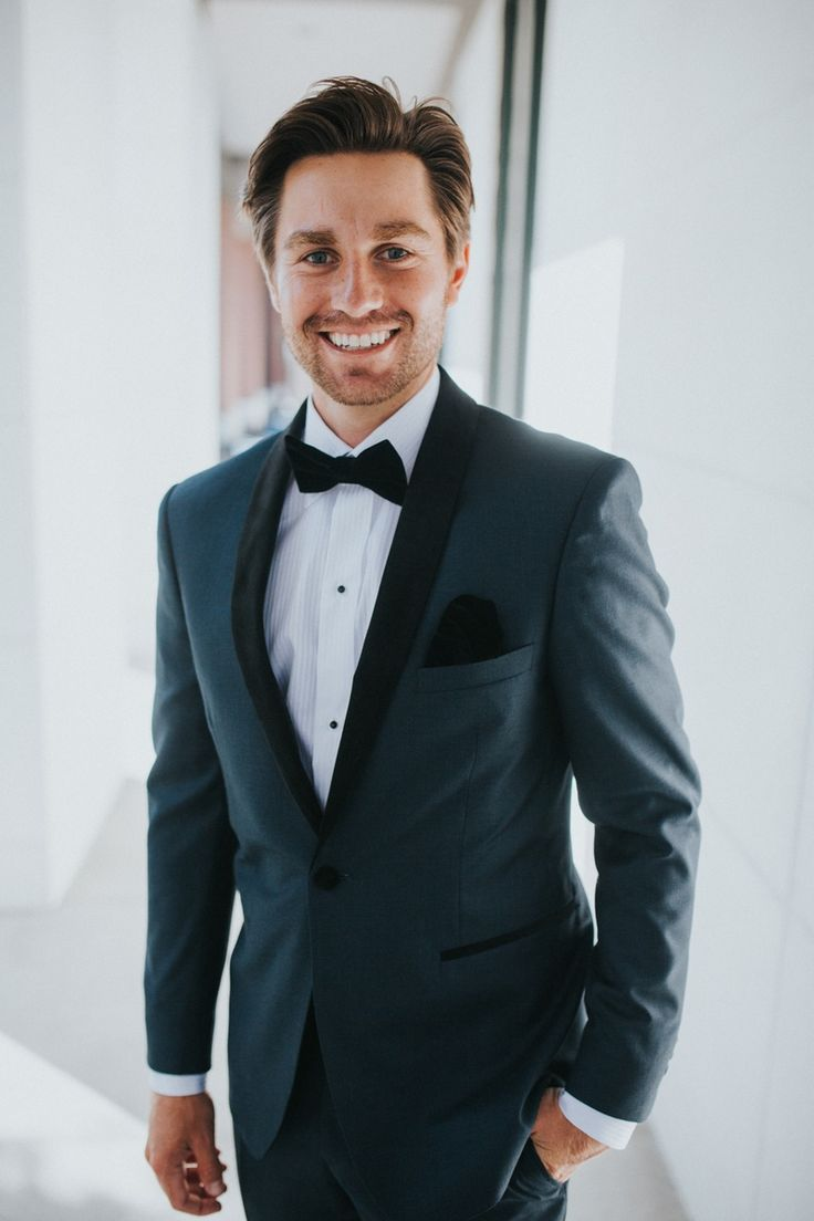 Groom in Medium-Navy Tuxedo    Photography: Jennifer Martin Photography   Read More:  http://www.insideweddings.com/weddings/a-pro-tennis-players-fall-wedding-featuring-a-moody-color-palette/997/