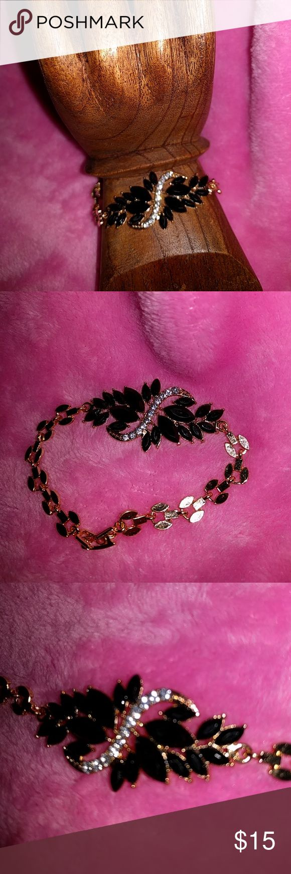 Beautiful Bracelet This beautiful bracelet with black stones and diamond like stones is just gorgeous. The blackstones hour of a Marquise shape in various sizes. The bracelet has a gold chain and a clasp. This is just a fun bracelet to wear. Accessories