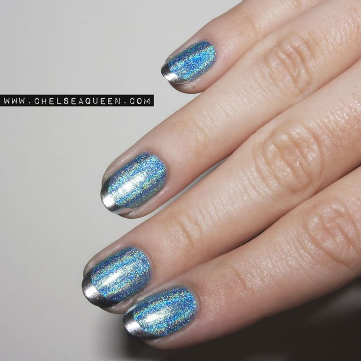 The blue holographic polish is Color Club Guilty Pleasures. For the tips, OPI Push and Shove.