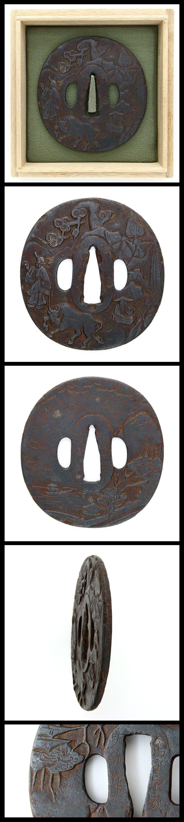 Edo Cowherd engraved on round shape iron Tsuba.