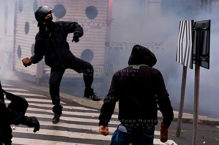 Milan, May 1, 2015 Mayday NoExpo Clashes protesters against police during the demonstration in downtown Milan, to protest against Universal Exposition Milano 2015.