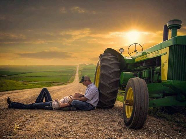 I love this pic it is so adorable. That's were I wanna be. Out in the country with someone I care deeply for and our tractor. Perfect picture.