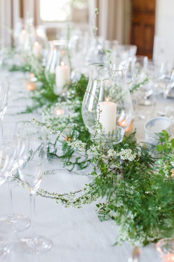 "Don't love flowers but want to have some ""life"" at your table?  The green garland is perfect.  It's low-key, simple, and looks gorgeous with any color palette."