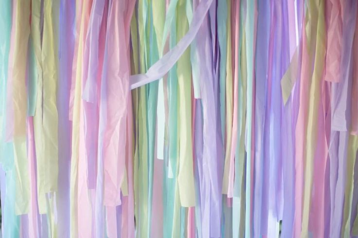 A shot of a finished photo backdrop, made from multicolored pastel tablecloths.