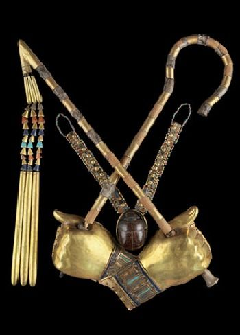 Found on Tutankhamon's body in his Tomb--golden hand covers holding the crook and flail of Egyptian Royalty.