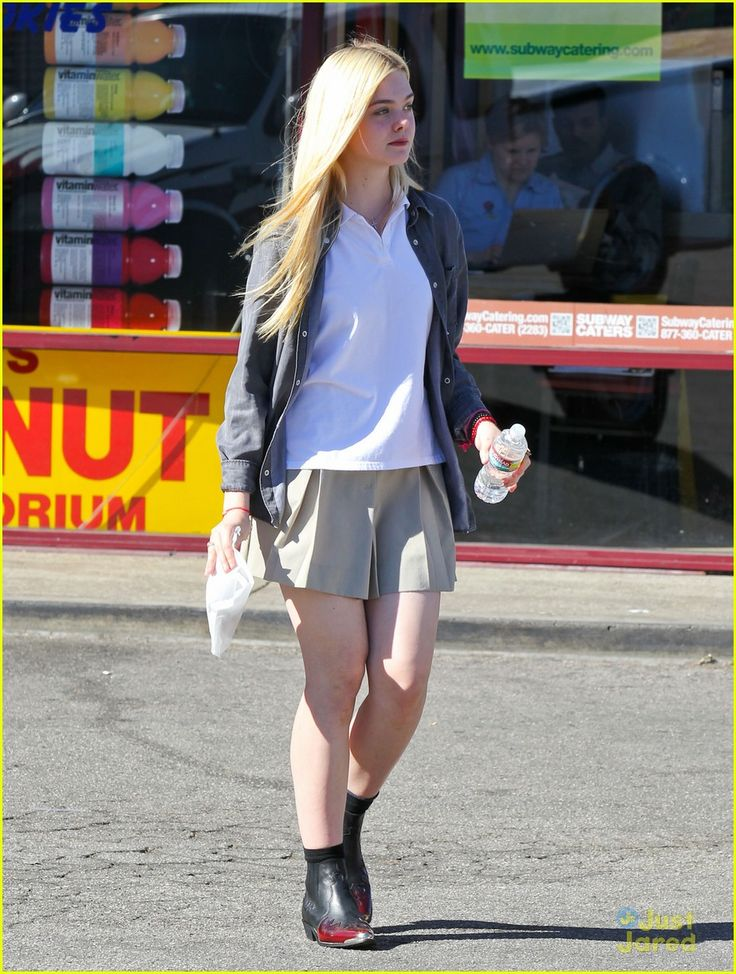 elle fanning sugar rush 08, Elle Fanning picks up a yummy, sugary treat on Tuesday afternoon (November 13) in North Hollywood, Calif.    The 14-year-old actress stopped by K's Donut Emporium…