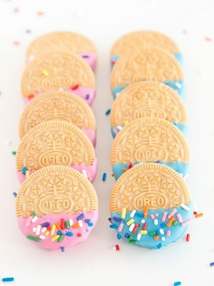 To add some extra pizzazz to store bought cookies  dip cookies in melted colored chocolate  and then add bright sprinkles before the chocolate hardens  Guests can choose pink or blue cookies depending on if they think the baby will be a boy or a girl
