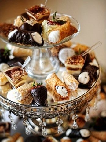 Chocolate and pastries on a tiered dessert stand.  Tip:  Use a large cake stand for the bottom tier and a smaller one for the top tier.