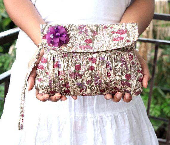 Handmade floral clutch field of flower screenprinted cotton in purple, violet and lavender. Decorated with purple beaded flower. This clutch bag is perfect