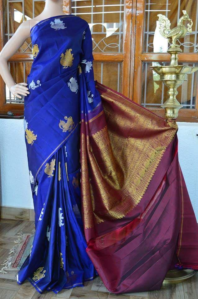 Blue pure zari pure kanchipuram silk saree with peacock zari and silver colour butta on full body and maroon colour zari rich pallu with maroon plan blouse. Code: A0417KA031511 Cost: 18500 INR Mail: vasthramsilk@gmail.com Whats app: 7019277192 #purekanchipuramsilksaree #kanjivaram