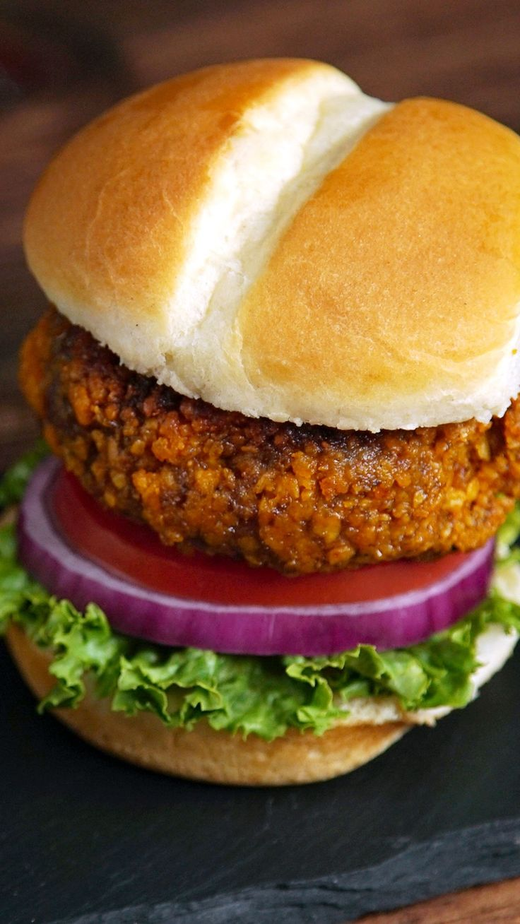 Recipe with video instructions: You're gonna get hooked on these cheese-stuffed hamburgers laced with nacho-flavored chips. Ingredients: 1 ½ cups Nacho Cheese Doritos, finely crushed , 1 lb 85% lean ground beef, 1 egg, 1 Tbsp mustard, 1 ½ tsp kosher salt, 1 tsp black pepper, ⅛ tsp cayenne, 2 oz Monterey Jack cheese, in small cubes, 1 Tbsp olive oil, Hamburger buns, Green leaf lettuce, Tomatoes, Red onion