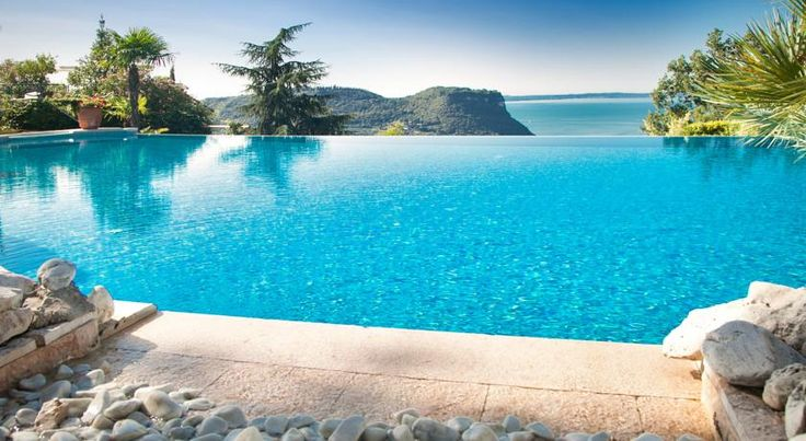 Hotel Madrigale - The Panoramic Resort Costermano Only 2 km from Lake Garda, Hotel Madrigale - The Panoramic Resort offers 2 swimming pools and lake views from its hilltop position in Marciaga. Cà degli Ulivi Golf Course is opposite the hotel.