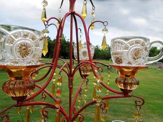 Thrift store chandelier crafted Tito a bird feeder