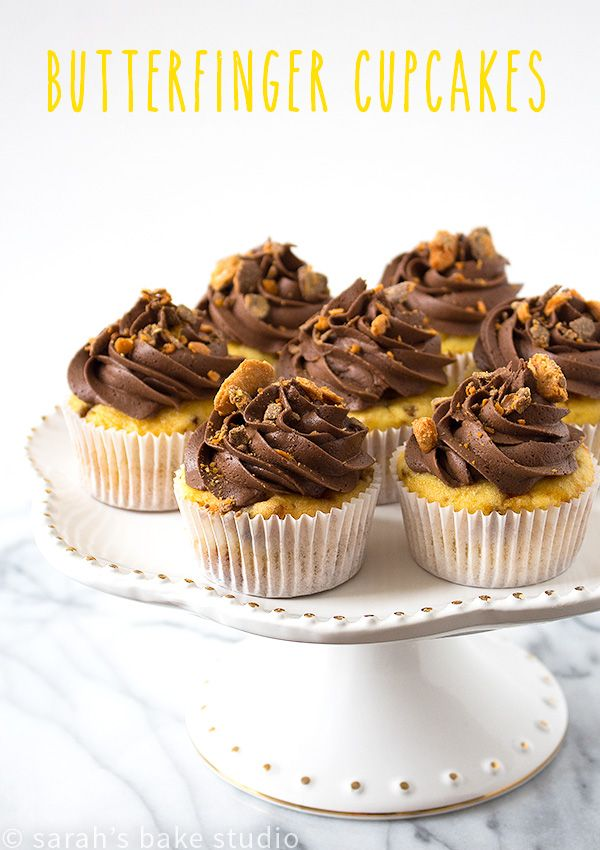 Butterfinger Cupcakes – buttery doctored butter cake mix and Butterfinger Baking Bits baked to cupcake perfection, topped with smooth chocolate buttercream, and sprinkled with bits of Butterfinger happiness! via @SarahBakeStudio