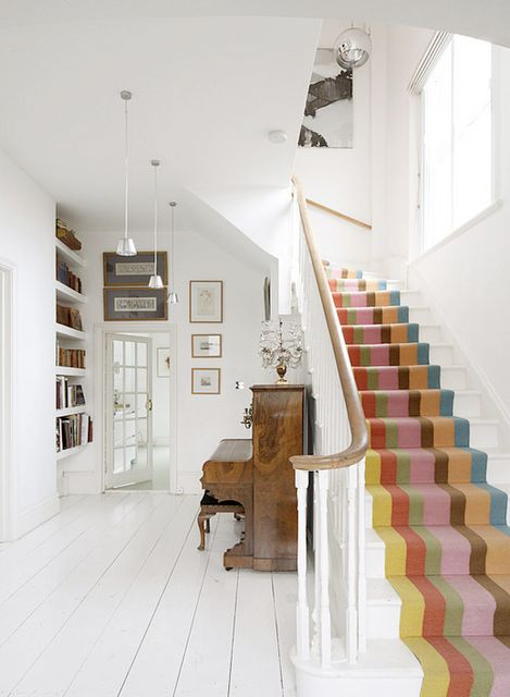 Stripey runner!  The piano room is a bit stark for my taste, but I really like the way the bold striped stairs steal color focus and how light and bright the room & stairs become.