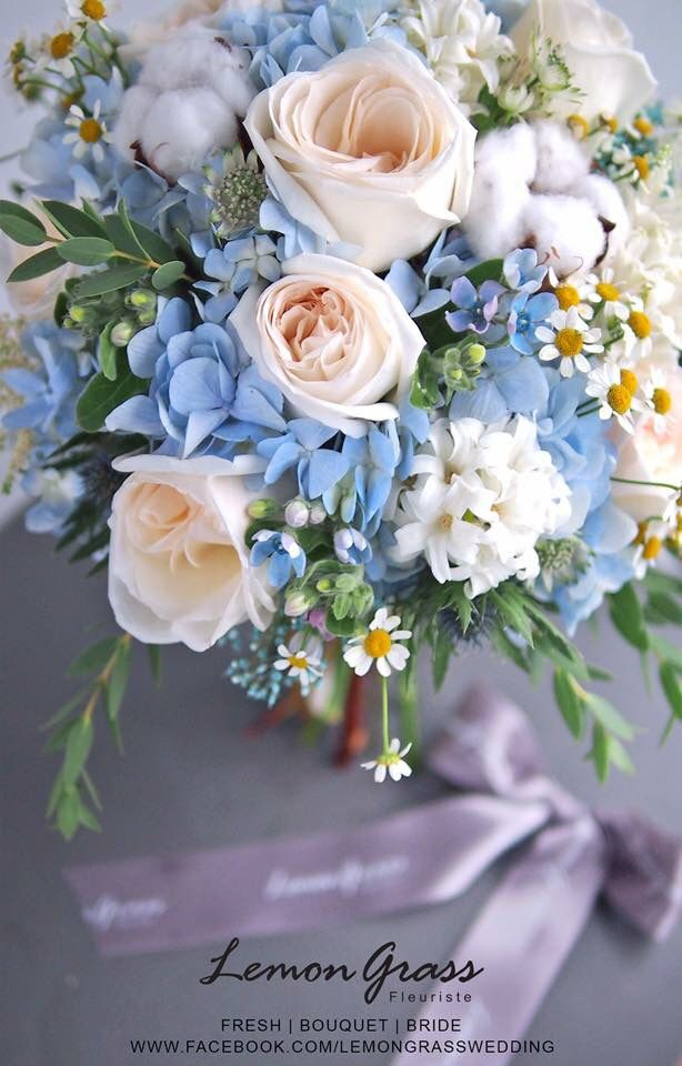 Love the blue hydrangeas and blush roses, not the arrangement as a bouquet though