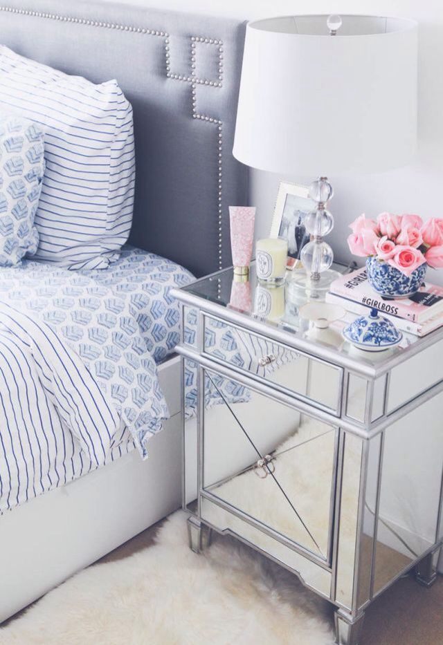 how to decorate a bedroom with mirrored nightstands love the soft blue bedding combined with the crystal table lamp and contrasting pink flowers in a blue