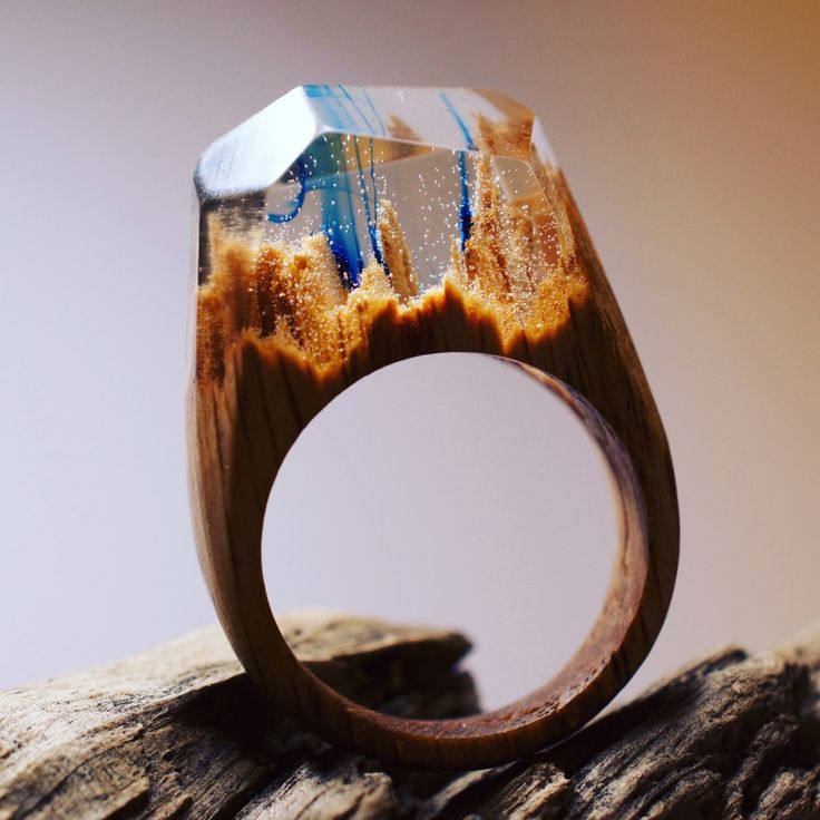 Formed from wood, resin, and beeswax, Canadian jeweler Secret Wood forms tiny worlds within the space of a finger. These environments contain everything from snowcapped mountains to deep blue lagoons, appearing like tiny snow globes atop one's hand. Like a gemstone, each ring has an ang