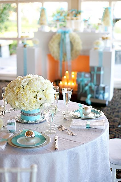 Tiffany blue & white décor. White Floral (roses & peonies) table arrangement in a Tiffany blue base.