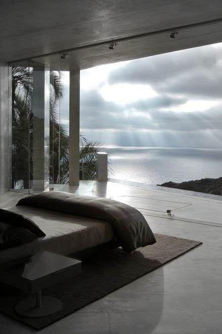 My Dream Bedroom!!! Love that large Window overlooking the ocean!