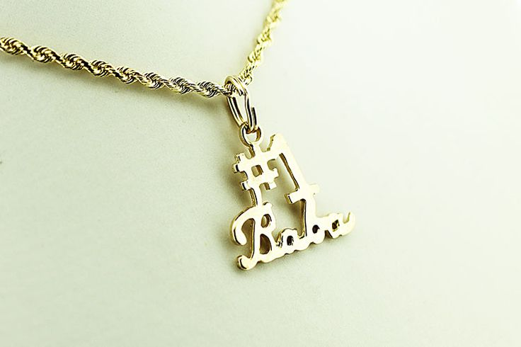"14kt gold pendant featuring the words ""#1 Grandmother"" in Ukrainian in script."