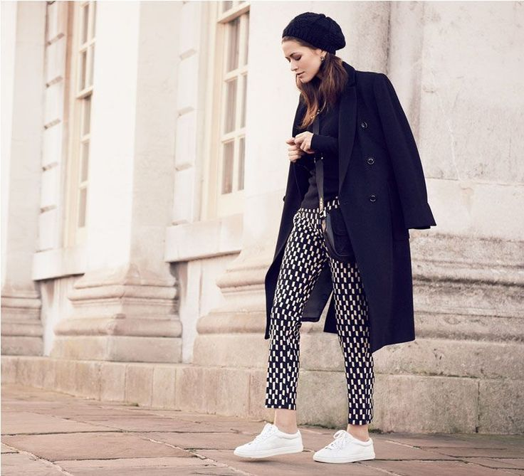 Model wears trench, roll neck and graphic-print trousers